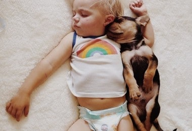 Sleeping baby and a puppy by Jessica Shyba
