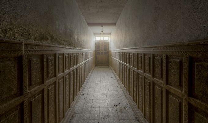abandoned corridor with door