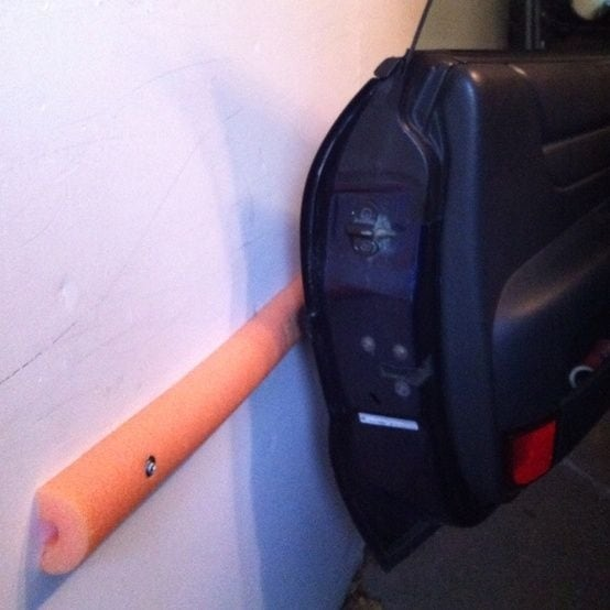 Foam noodles in your garage can save your door and the wall.