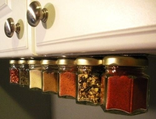 Put a magnet strip under your cabinets to store spices.