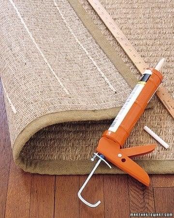 Use acrylic-latex caulk to keep rugs from slipping.