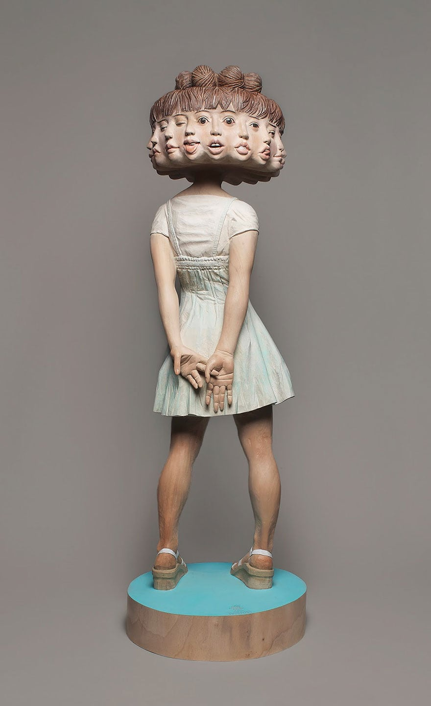 Wood-Sculptures-Of-Bizarrely-Twisted-Characters-By-A-Surreal-Japanese-Artist-10