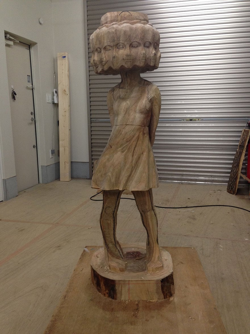 Wood-Sculptures-Of-Bizarrely-Twisted-Characters-By-A-Surreal-Japanese-Artist-7