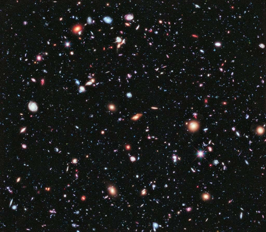 100s of galaxies seen through the Hubble Deep Field (HDF), as they were 10 billion years ago.