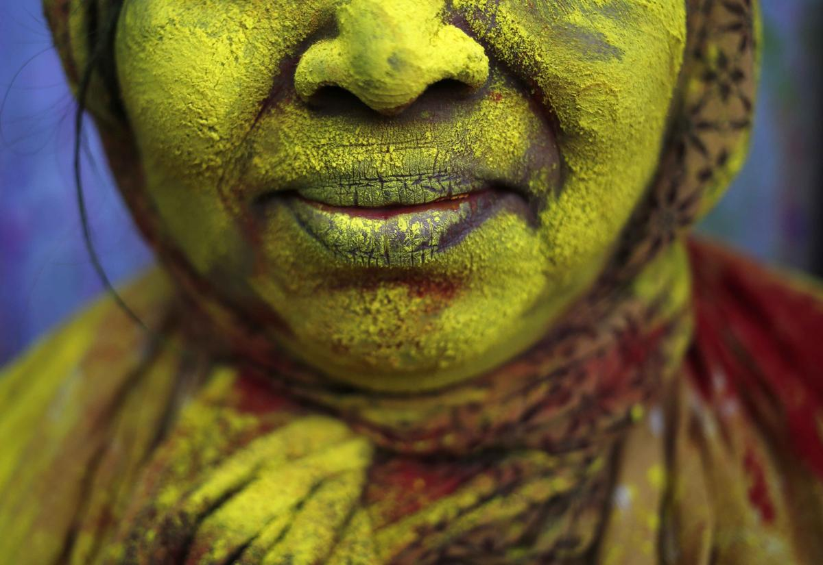 The face of a widow was daubed in color after the Holi celebrations at Vrindavan on March 4. (Anindito Mukherjee/Reuters)