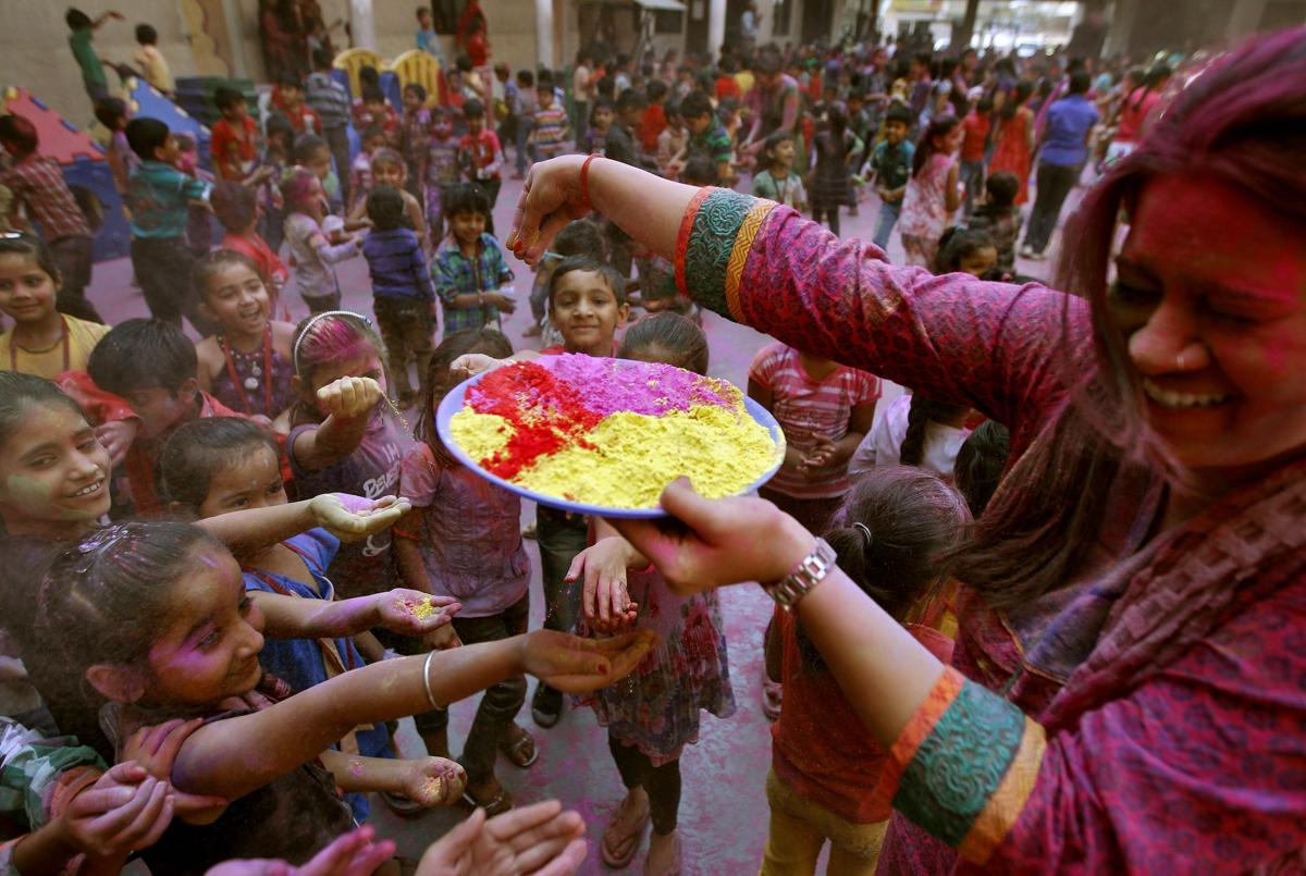 Water fell on the colored hand of a man dancing during Holi celebrations in Gauhati, India, on March 6. (Anupam Nath/Associated Press)