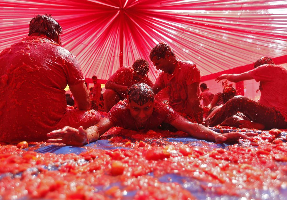 People played with tomato pulp as part of the Holi celebrations in the western Indian city of Ahmedabad on March 6. (Amit Dave/Reuters)