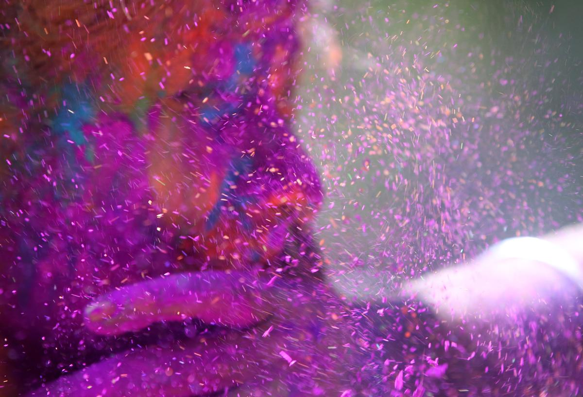 A man smeared the face of a woman with colored powder during celebrations marking Holi, the Hindu festival of colors, in Mumbai on March 6. The streets and lanes across most of India turn into a large playground where people of all faiths throw colored powder and water at each other. (Rajanish Kakade/Associated Press)