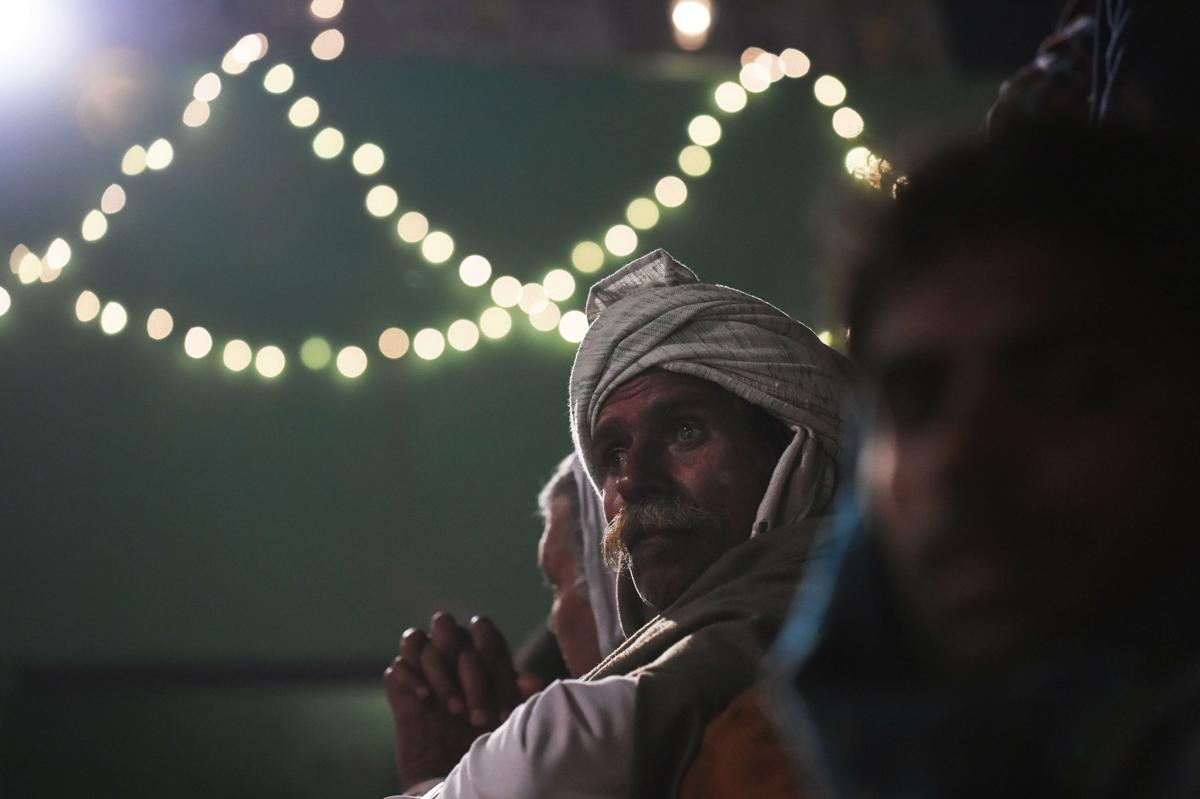 An Indian villager waited near a Hindu temple as a priest readied himself to run through a huge bonfire in the northern town of Phalem on March 6. Hundreds of villagers from the farming town crowded rooftops and a small square as the priest walked through a raging fire in a ritual that marks the burning of demon Holika. (Roberto Schmidt/AFP/Getty Images)