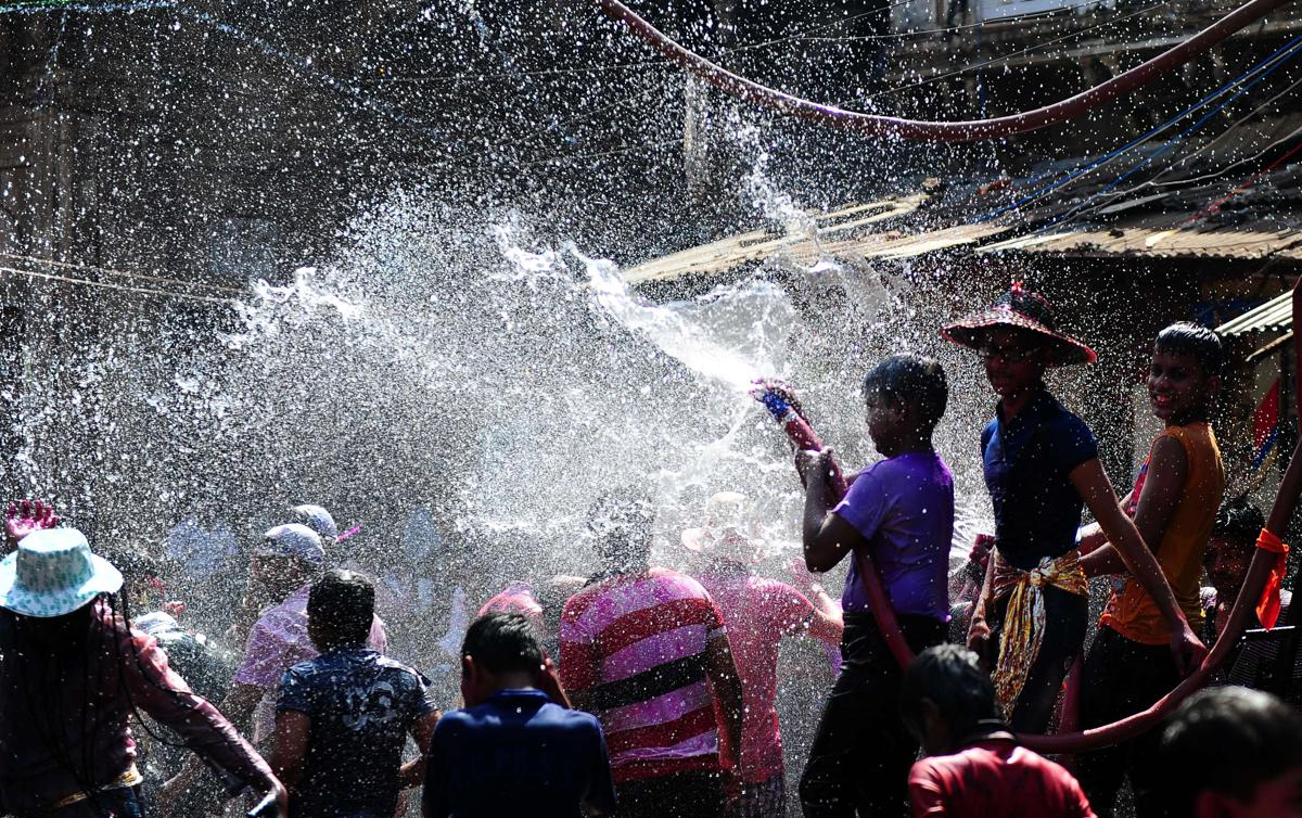 Indian children sprayed water as they celebrated Holi in Allahabad on March 6. (Sanjay Kanojia/AFP/Getty Images)