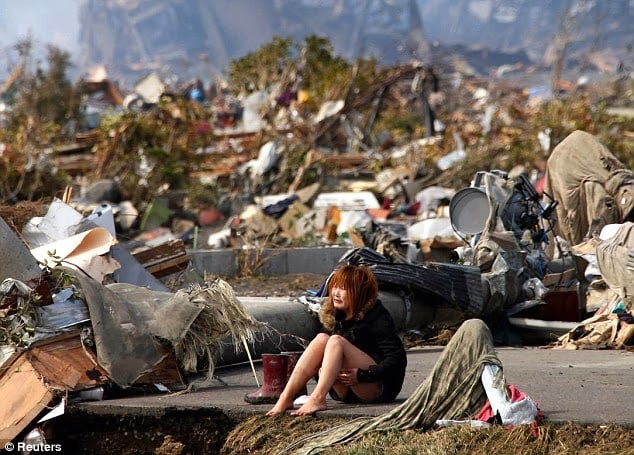 Girl devastated after the tsunami that hit Japan in 2011.