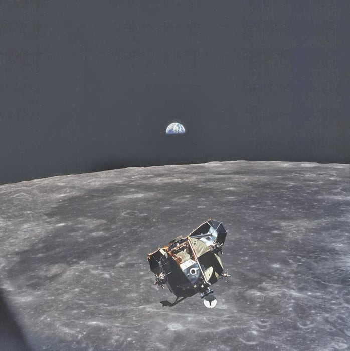 This photo was taken by astronaut Michael Collins, when he took this photo he was the only human, alive or dead, that wasn't in the frame of this picture. He travelled with Buzz Aldrin and Neil Armstrong and orbited the moon whilst they were landing to study the surface of the moon from farther out.