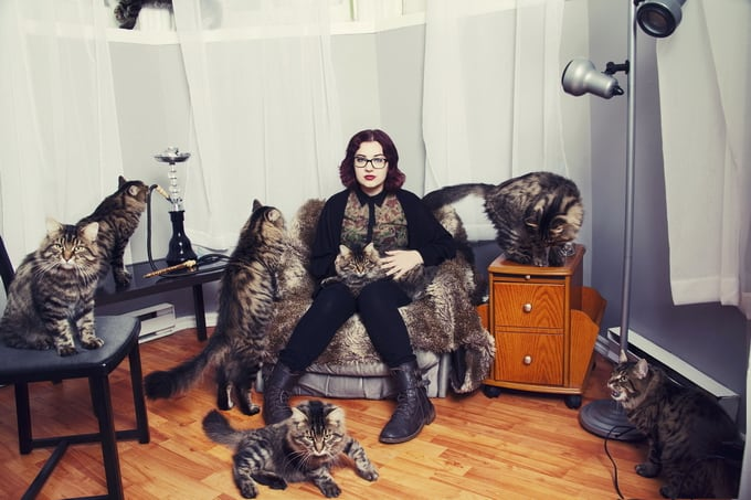 Alex with Dali the cat. (Andreanne Lupien/Caters News)