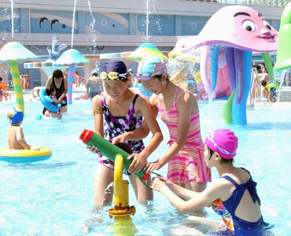 Laborers and youth visit Munsu Water Park during a continued period of hot weather in Pyongyang August 8, 2014. (Photo by Reuters/KCNA)