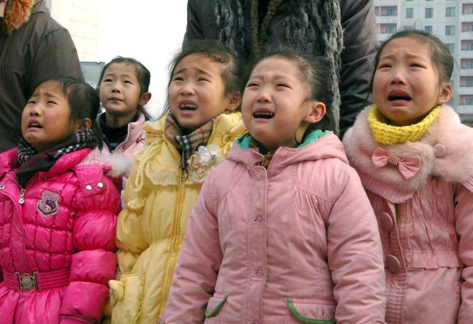 North Koreans mourn their deceased leader Kim Jong-il in Pyongyang December 27, 2011. (Photo by Reuters/KCNA)