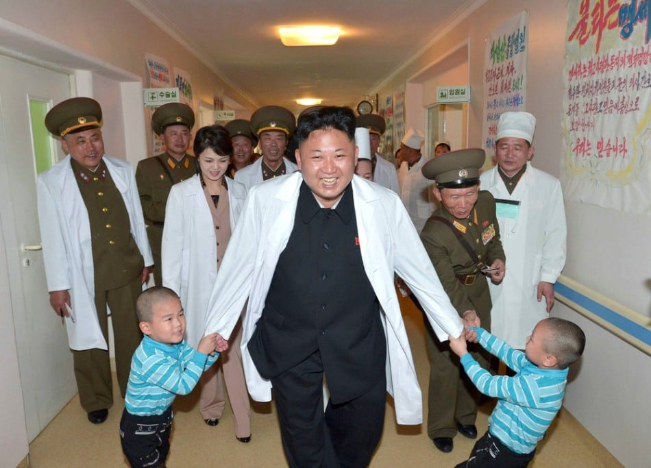 North Korean leader Kim Jong Un plays with children during a visit to the Taesongsan General Hospital in Pyongyang May 19, 2014. (Photo by Reuters/KCNA)
