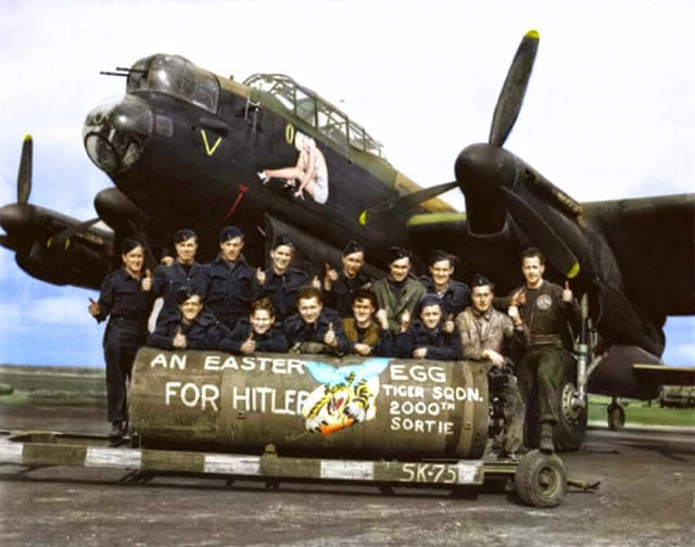 "F/L J. F. Thomas and the crew of Avro Lancaster Bomber 'B' MkI 'Victorious Virgin' RF128 QB-V of RCAF 424 Squadron ""Tiger"" Squadron on the 21st of March 1945. (probably taken at the Skipton-on-Swale, North Yorkshire airfield). (Colorized by Tom Thounaojam from India)"