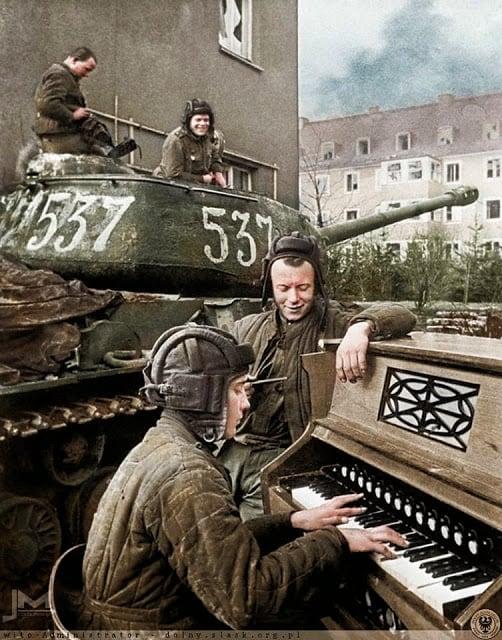 Crew members of Nº537 Soviet IS-2 tank of the 87th Guards Heavy Tank Regiment take a break in Breslau (now Wrocław in Poland) 27th April 1945. (Photographer - Anatoli Egorov. Colorized by Jiří Macháček from the Czech republic)