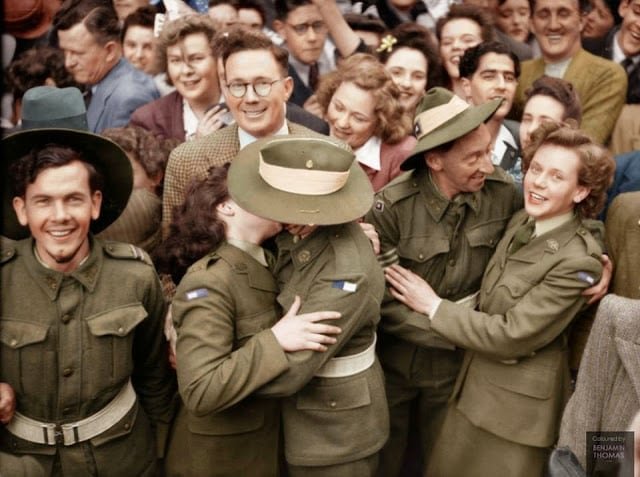 Australian soldiers mingle with a section of the crowd gathered in Martin Place during the Victory in the Pacific celebrations, Sydney, 15 August 1945. (Colorized and researched by Benjamin Thomas from Australia)