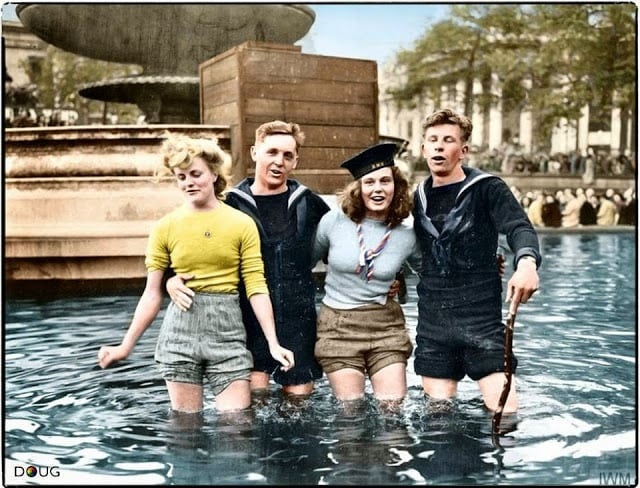 Two British sailors celebrate VE Day with their girlfriends in the fountains at Trafalgar Square. London, England. Tuesday the 8th of May 1945. (Source - © IWM EA 65799. United States Army Signal Corps photographer T G Massecar. Colorized by Doug)
