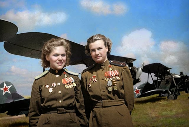 Soviet Air Force officers, Rufina Gasheva (848 night combat missions) and Nataly Meklin (980 night combat missions) decorated as 'Heroes of the Soviet Union' for their service with the famed 'Night Witches' unit during World War II. They stand in front of their Polikarpov Po-2 biplanes. (Colourisation and research by Olga Shirnina from Russia)