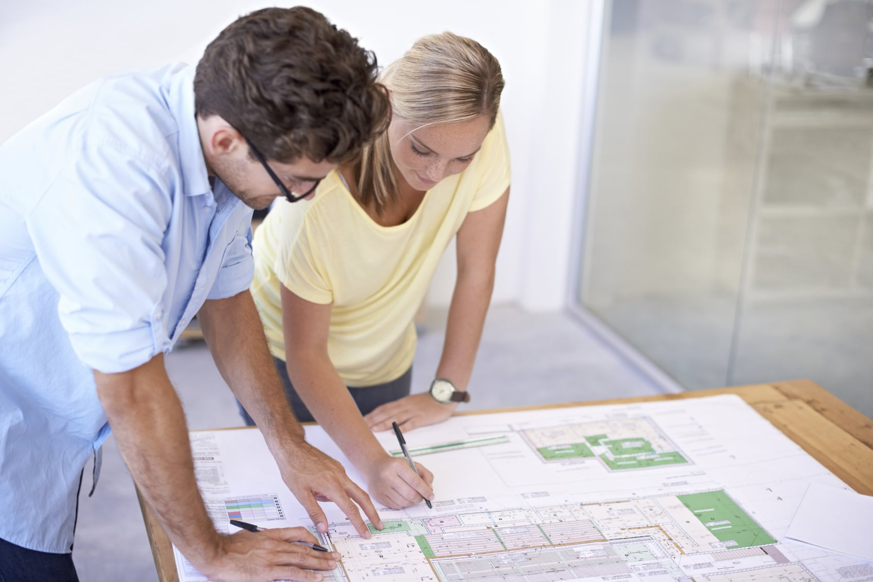 A group of architects discussing elements of a building plan