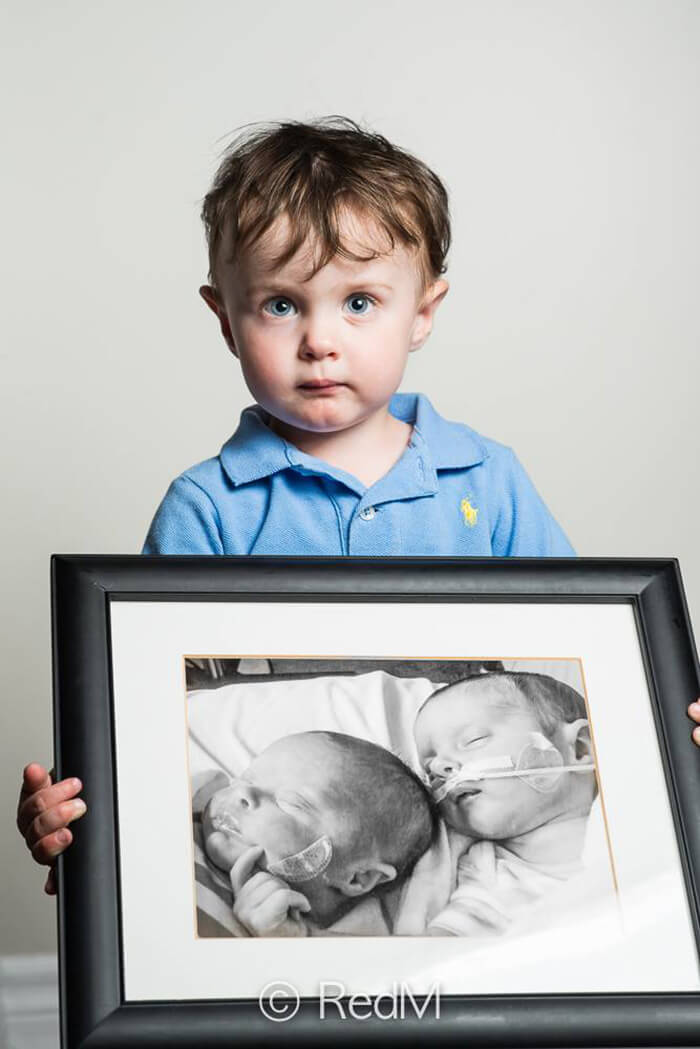 Noah, born at 32 weeks. His twin sister Victoria, left in the framed picture, died after living 1 month