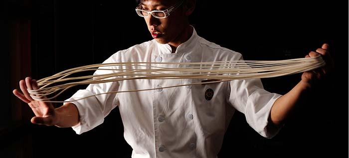 chef handling noodles