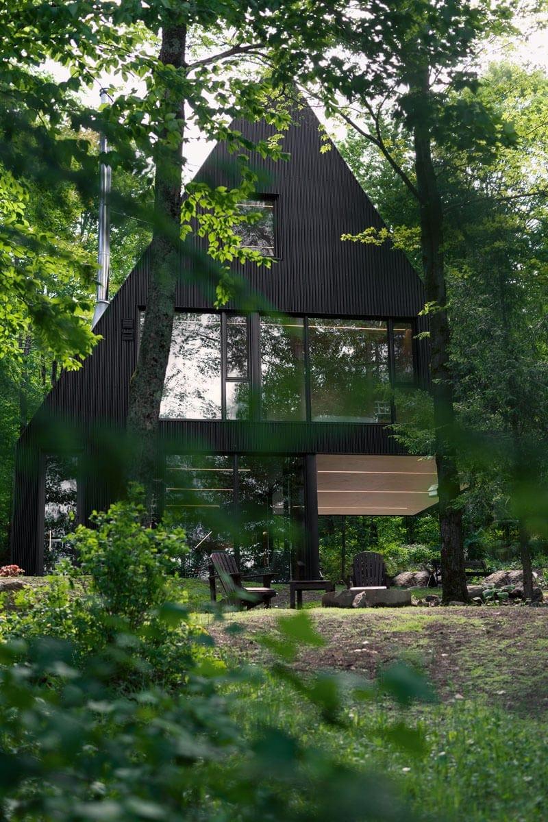 modern cabin hemlock forest quebec canada 1