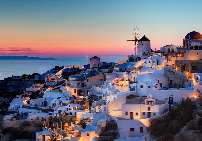 take in the stunning views of the mediterranean sea from the greek island of santorini