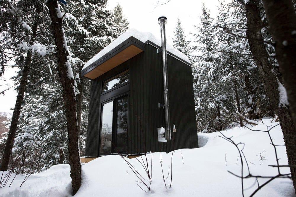 black cozy cabin ontario forest 1