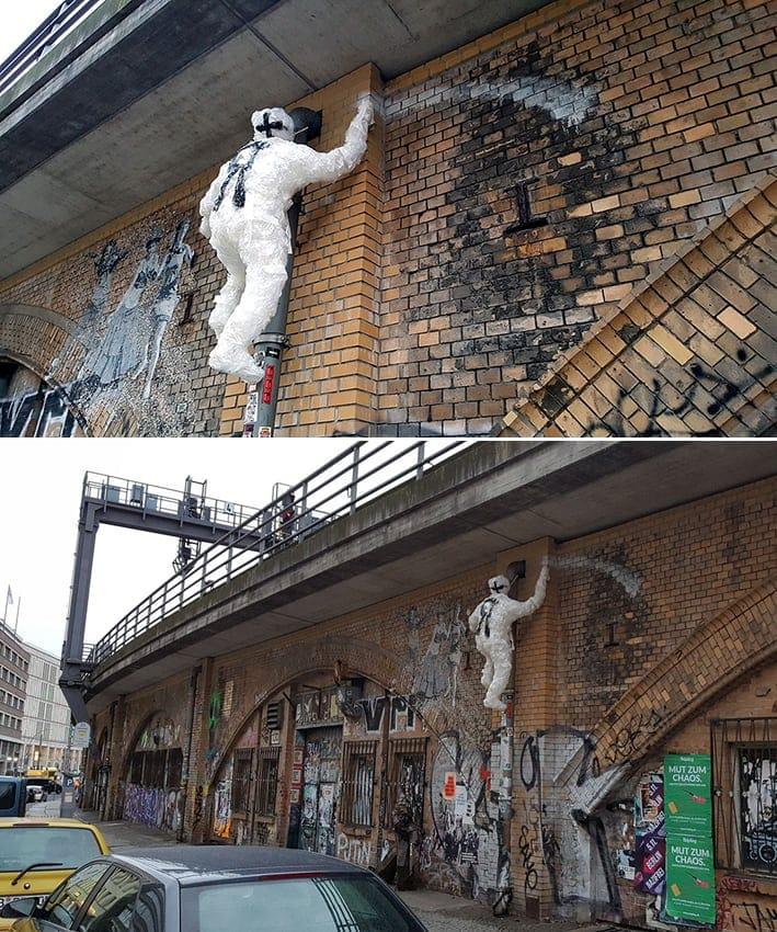 climbing sprayer tapestreetart sculpture ostap selfmadecrew berlin2016