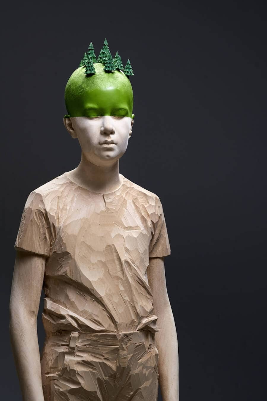 wood sculptures that highlight environmental decay by willy vergine 2