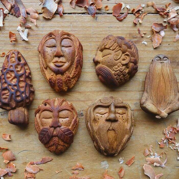 carved totems avocado stone faces jan campbell fy 3