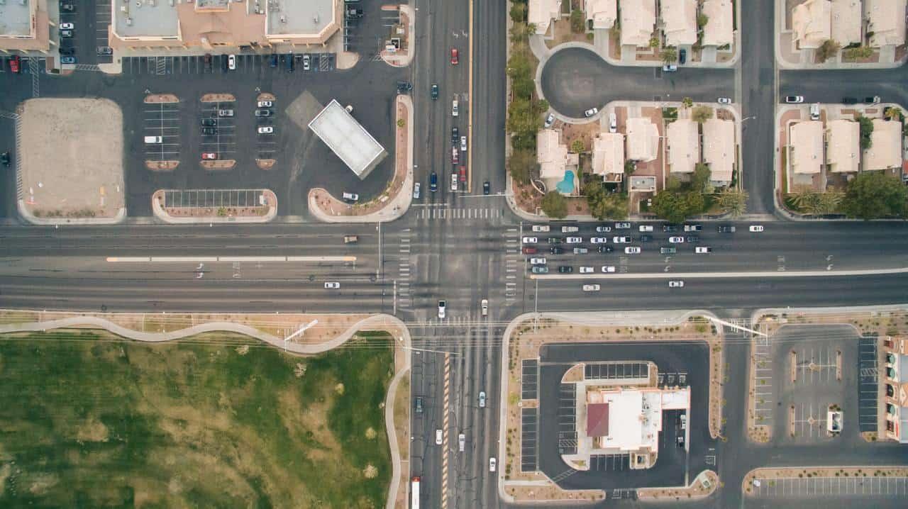 bird s eye view cars crossing crossroad