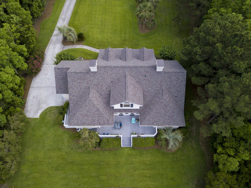 aerial view of large home with new roof on 2STJNQL