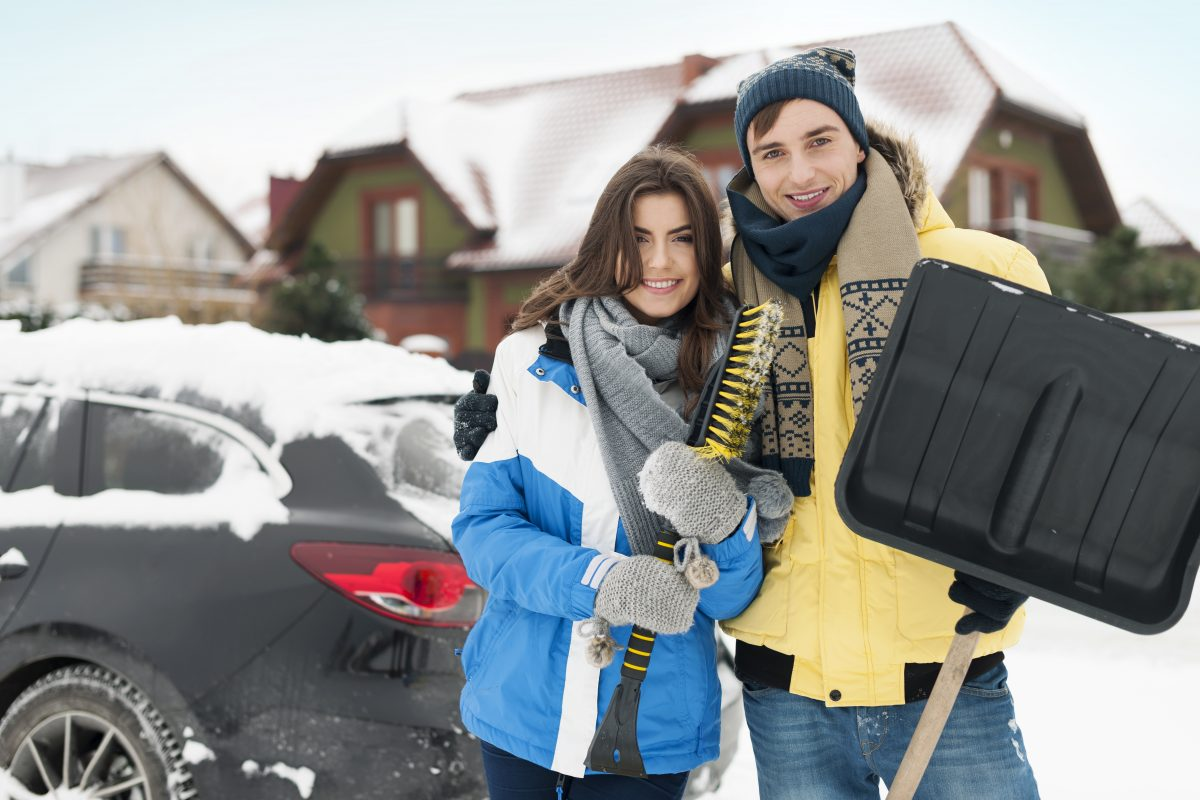 happy couple are ready to cleaning car from snow LF7MKVN 1