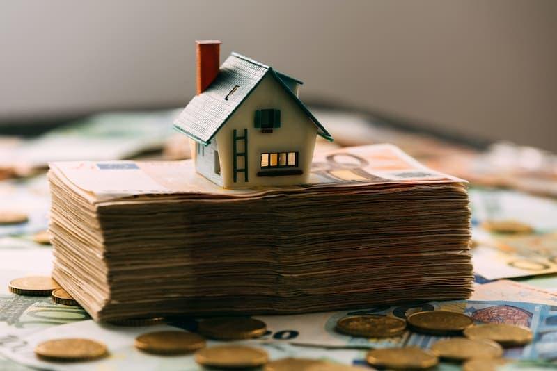 house model on cash stack closeup PX9LWJN