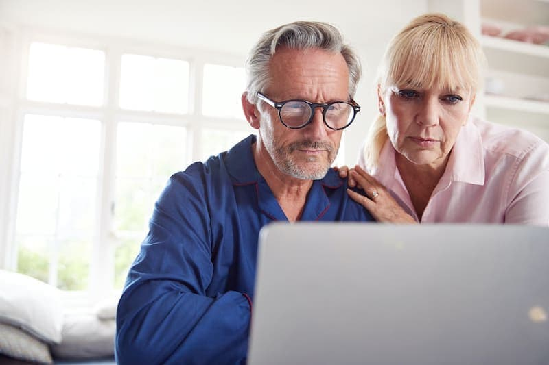 mature couple at home looking up information 5HRL2X4