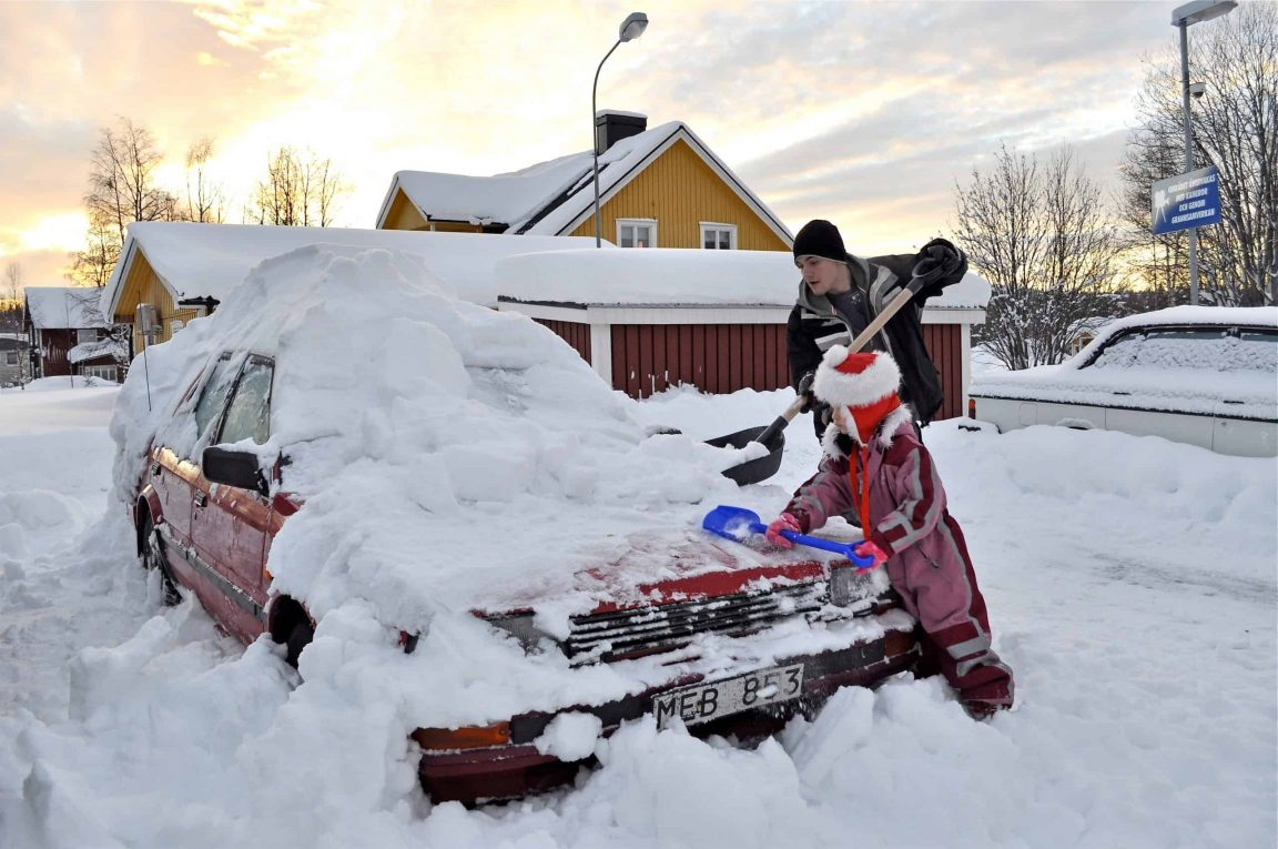 nominated brother and sister cleaning a car from snow in the north of sweden snow car cold winter t20 ywzBwR scaled