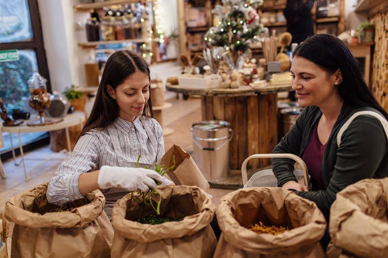 shop assistant serving customer in packaging free X7LDJRZ