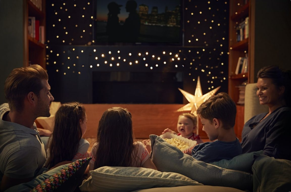 family enjoying movie night at home together PPYBLEG