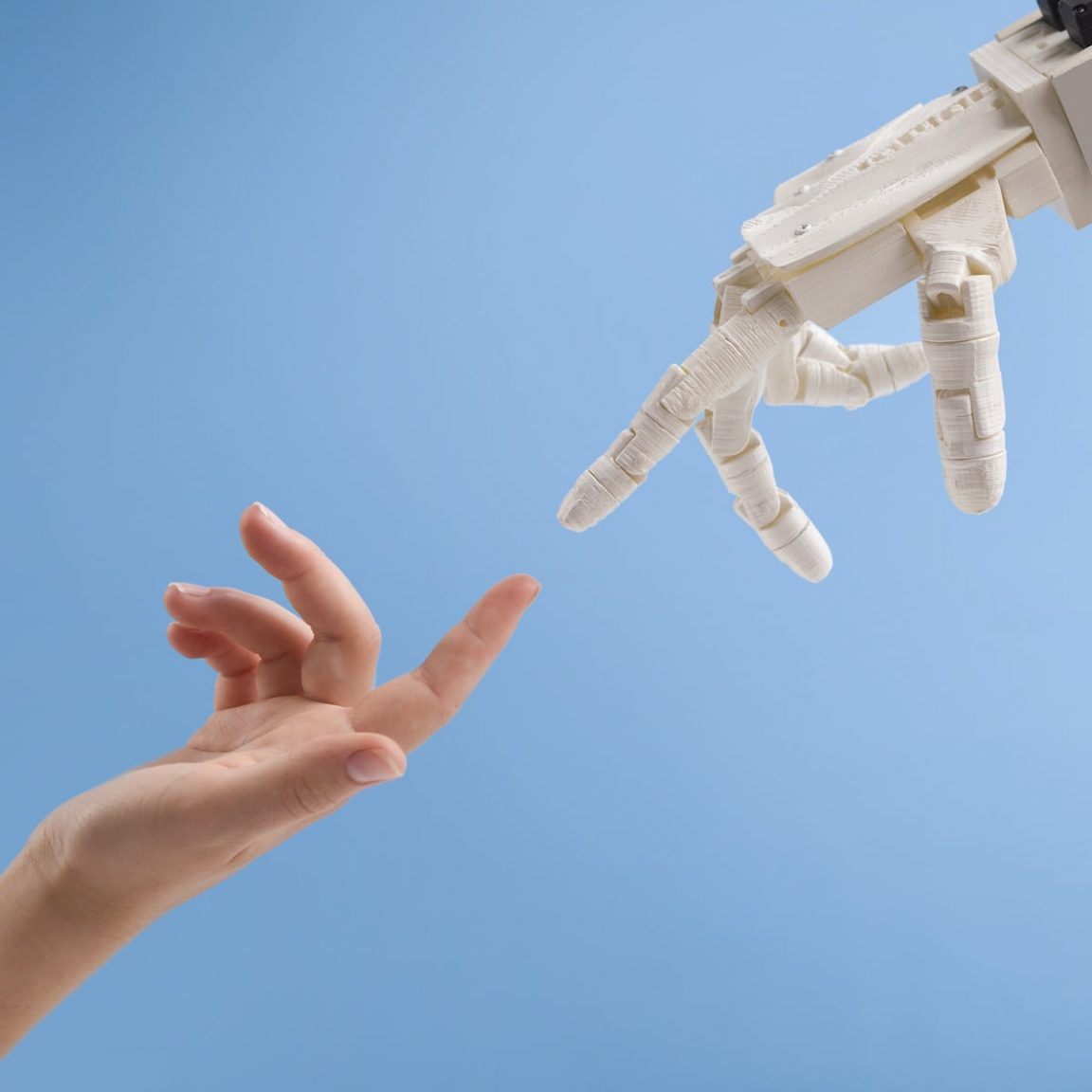 female and robot hands reaching to each other on 6289XCD