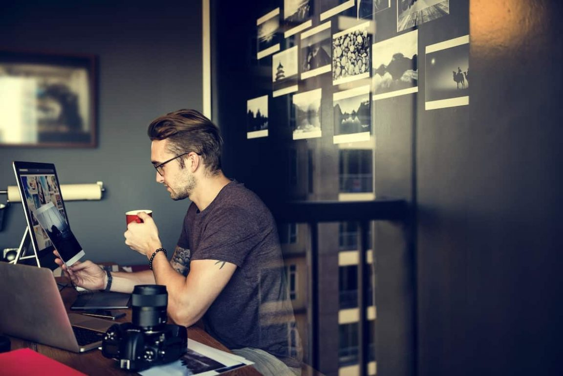 man busy photographer editing home office concept PYMZK4W