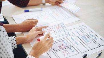 ui designers discussing interface BL3TC7Q