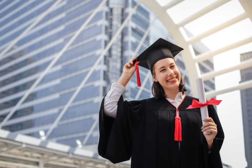 young student woman smiling and holding diploma certificate paper graduation concept t20 ZVRyLa