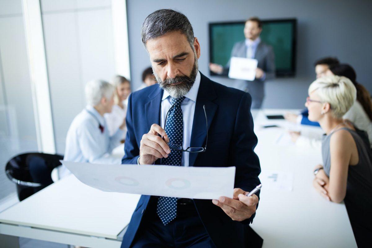 shot of thinking financial advisor businessman WBVSK8G