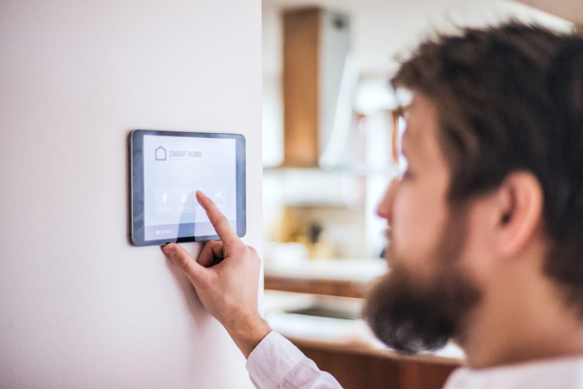 A tablet with smart home control system.