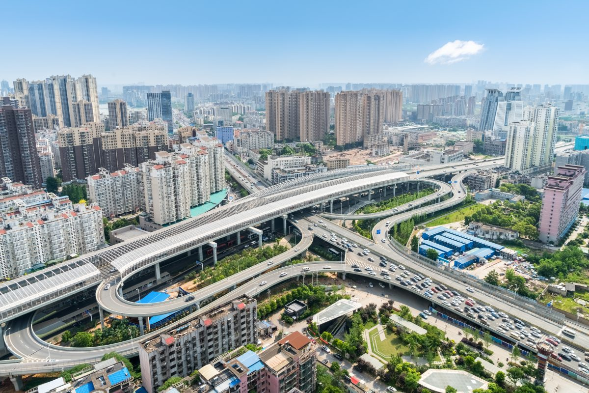 aerial view of city interchange overpass with blue sky, beautiful wuhan cityscape with urban traffic development, China