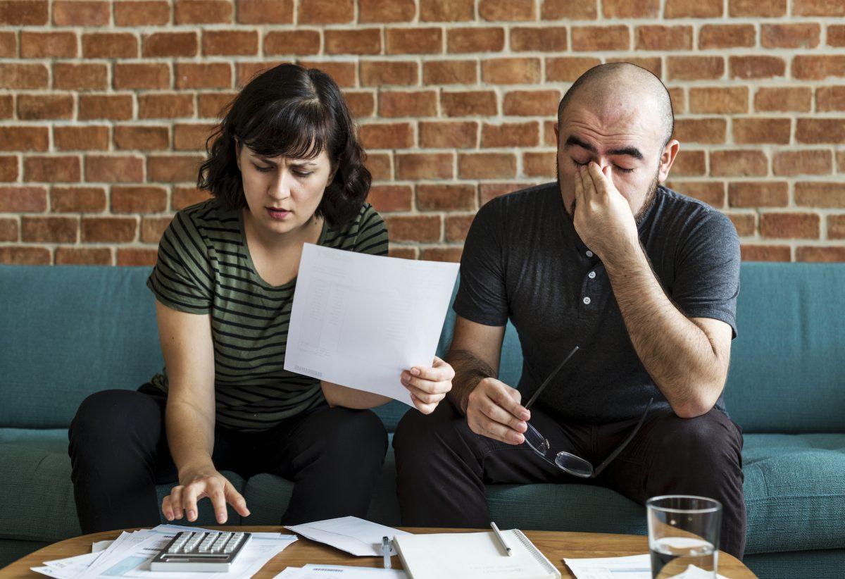 couple managing the debt YJLK3Z8